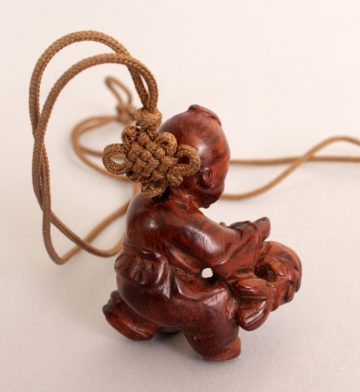 Japenese carved wood netsuke of Chinese boy 5
